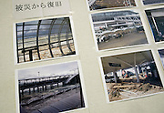 Photos showing the devastation caused at the airport by the March 11 quake and tsunami are displayed on a wall at Sendai airport in Natori, Miyagi Prefecture, Japan on 14 April, 2011. .Photographer: Robert Gilhooly