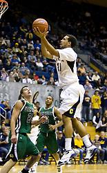 December 28, 2009; Berkeley, CA, USA;  California Golden Bears forward Omondi Amoke (21) shoots over Utah Valley Wolverines guard Aaron England (24) during the second half at the Haas Pavilion.  California defeated Utah Valley 85-51.