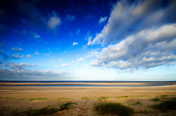 Vast empty beach of Burnham Overy Staithe, North Norfolk Coast, England, UK.