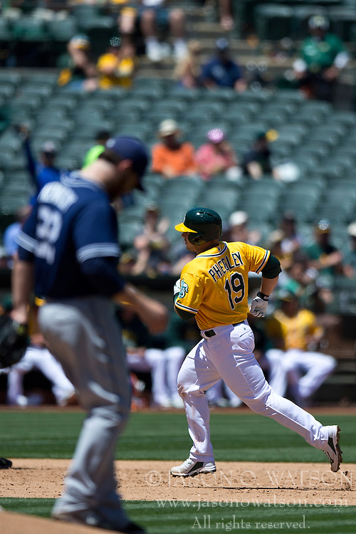 OAKLAND, CA - JUNE 18:  Josh Phegley #19 of the Oakland Athletics rounds the bases after hitting a home run off of Ian Kennedy #22 of the San Diego Padres during the sixth inning at O.co Coliseum on June 18, 2015 in Oakland, California. The San Diego Padres defeated the Oakland Athletics 3-1. (Photo by Jason O. Watson/Getty Images) *** Local Caption *** Josh Phegley; Ian Kennedy