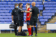 Luton Town midfielder Jordan Clark (18) receives medical treatment, head bandage, during the EFL Cup match between Reading and Luton Town at the Madejski Stadium, Reading, England on 15 September 2020.