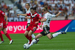 26.06.2011, Olympiastadion Berlin, Berlin, GER, FIFA Women's Worldcup 2011, Gruppe A,  Deutschland (GER) vs. Canada (CAN), im Bild Simone Laudehr (GER #06, Duisburg) gegen 8 Diana MATHESON // during the FIFA Women's Worldcup 2011, Pool A, Germany vs Canada on 2011/06/26, Olympiastadion, Berlin, Germany.   EXPA Pictures © 2011, PhotoCredit: EXPA/ nph/  Kokenge       ****** out of GER / SWE / CRO  / BEL ******