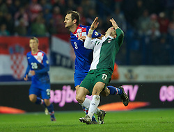 OSIJEK, CROATIA - Tuesday, October 16, 2012: Wales' Gareth Bale in action against Croatia's Josip Simunic during the Brazil 2014 FIFA World Cup Qualifying Group A match at the Stadion Gradski Vrt. (Pic by David Rawcliffe/Propaganda)