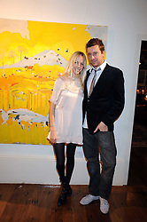 Artist TAHNEE LONSDALE and her husband LUKE COLSON at an exhibition of her work held at The Commander, 47 Hereford Road, London on 8th October 2008.