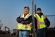 Humir Construction Project Manager Juan Arreloa poses with Operations Manager and nephew Hugo Ramirez at the company's equipment yard on Chicago's near southwest wise.
