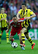 (R) Robert Lewandowski of Dortmund fights for the ball with (L) Franck Ribery of Monachium during the UEFA Champions League Final football match between Borussia Dortmund and Bayern Munich at Wembley Stadium in London on May 25, 2013...England, London, May 25, 2013..Picture also available in RAW (NEF) or TIFF format on special request...For editorial use only. Any commercial or promotional use requires permission...Photo by © Adam Nurkiewicz / Mediasport