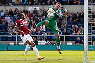 Matt Ingram of Wycombe Wanderers spills the ball under pressure from Emile Sinclair of Northampton Town resulting n a goal for Northampton Town to make it 0-1  during the Sky Bet League 2 match at Adams Park, High Wycombe<br /> Picture by David Horn/Focus Images Ltd +44 7545 970036<br /> 18/04/2014