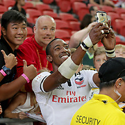 Perry Baker's blazing speed has made him the hotest star on the HSBC 7's Circuit, always asked for selfies here at the Singapore Sevens, Day 1, National Stadium, Singapore.  Photo by Barry Markowitz, 4/15/17