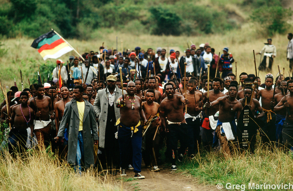 KwaZulu Natal, South Africa 1992-3. The warriors of IFP warlord Sqoloso Xolo march at a funeral for a comrade killed in political violence, KwaZulu Natal. Xolo was himself killed in intra IFP rivalry.