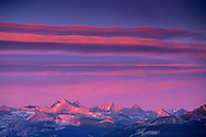 Alpenglow at sunset on clouds above the Sierra crest from atop Sentinel Dome, Yosemite National Park, CALIFORNIA