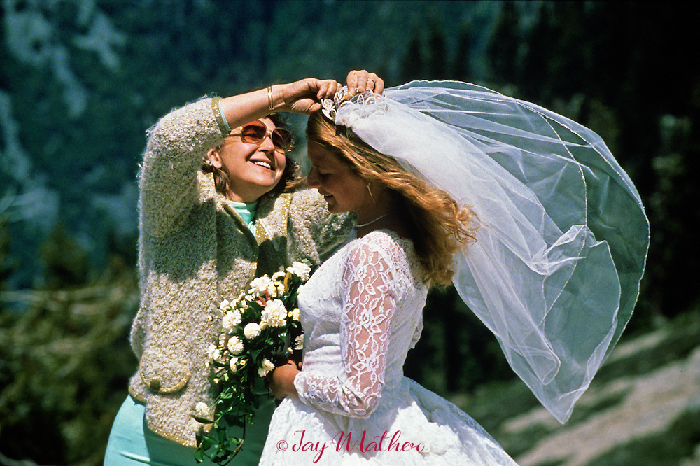 Nancy Hedqvist gets help with her veil from her mother before the wedding.   Federal magistrate Don Pitts performed the ceremony on the summit of Sentinel Dome.  May 28, 1989.