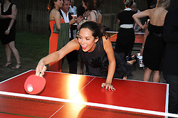 MYLEENE KLASS playing Table Tennis at the annual Serpentine Gallery Summer party this year sponsored by Jaguar held at the Serpentine Gallery, Kensington Gardens, London on 8th July 2010.  2010 marks the 40th anniversary of the Serpentine Gallery and the 10th Pavilion.