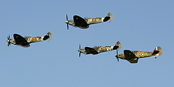 Three Spitfires And A Hurricane That Made An Historic Flight Over The Kent Countryside In Honour Of Remembrance Sunday, Biggin Hill, Kent,  Sunday, 10th November 2013. Picture by i-Images