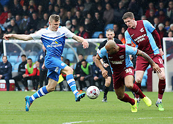 Peterborough United's Harry Anderson takes on Scunthorpe United's Marcus Williams - Photo mandatory by-line: Joe Dent/JMP - Mobile: 07966 386802 - 03/04/2015 - SPORT - Football - Scunthorpe - Glanford Park - Scunthorpe United v Peterborough United - Sky Bet League One