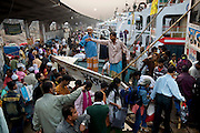 Travelers crowd onto ferries at the Sadarghat dock on the Buriganga River in Dhaka, Bangladesh. (From the book What I Eat: Around the World in 80 Diets.) The river acts as both a highway and a sewer, with 80 percent of the city's raw sewage draining into it from different parts of the city.