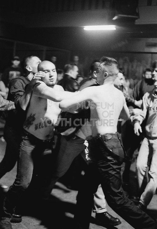 Bunch of burly men having a fight in a club, Russia, 2003