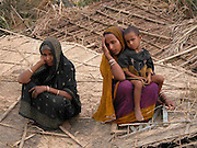 """Wails of """" Sob haraya galo"""" reverberates Kalapani .By Shib Shankar Chatterjee  .Dhubri, April 23: Heart wrenches as one reaches the tornado-hit villages in Kalapani. It seems as if hoards of wild Elephants trampled everything and anything that came across its way. Wails of """" Sob haraya galo"""" (everything is finished) rents the air.  .There was not a single house to be seen in all the six villages this correspondent visited today. Nandia, Patangitola, Dakin Bhorakati, Bengarbhaita, Toppara and Badia Beel resemble a single area with all men made landmarks uprooted by Mother Nature.  .31 people including 9 children were dead, 32 missing, 250 seriously injured and more than 10,000 have been left homeless in the wake of a powerful tornado that struck the region at around 7 pm and continued its destruction for almost 30 minutes on Tuesday evening. The dead includes 15 males and 16 females. There are reports of deaths of 30 domesticated animals also.   .Though casualty and damage reports remain incomplete, but the massive relief efforts by the district administration along with BSF have succeeded in regaining the confidence among the affected people. Deputy commissioner of Dhubri district, P Baruah visiting the tornado-ravaged areas and monitored the relief operation himself. Two relief camps have been organized for the affected people.     .Pics- SHIB SHANKAR CHATTERJEE.From : .SHIB SHANKAR CHATTERJEE,..A. C. Dasgupta Road, Ward Number - II,.Post Office & District - DHUBRI (Assam),.Pin Code Number - 783 301, (INDIA),.Phone Number -     +91-3662-231329 (R),.Fax     Number -     +91-3662-230076 (O),.Phone Number (Guwahati) -  +91-361-2474330 (P. P.),.E-mail Address - shibshankarc@rediffmail.com...    shibshankarc@yahoo.com...    shibshankarc@hotmail.com...    cshibshankar@sify.com. ."""