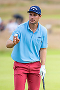 Andrea Pavan (ITA) acknowledges the crowd after making a birdie on the 14th hole during the third round of the Aberdeen Standard Investments Scottish Open at The Renaissance Club, North Berwick, Scotland on 13 July 2019.