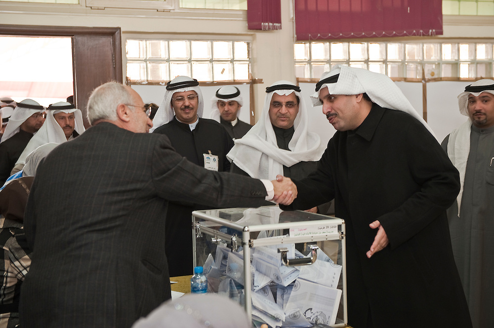 Kuwaiti Minister of Information Sheikh Hamad Jaber Al-Ali Al-Sabah (2nd from right) and Justice, Education and Higher Education Minister Ahmad Al-Mulaifi (3rd from right),  tour a polling station in Kuwait City during the Feb. 2 , 2012 parliamentary elections. According to local media, the information minister expressed optimism that the elections would lead up to the creation of a parliament that would deliver and push forward the development agenda. The justice minister told reporters that he was confident that the voting process would run smoothly. Some 285 candidates are running in the polls to vote for a new 50-seat parliament.