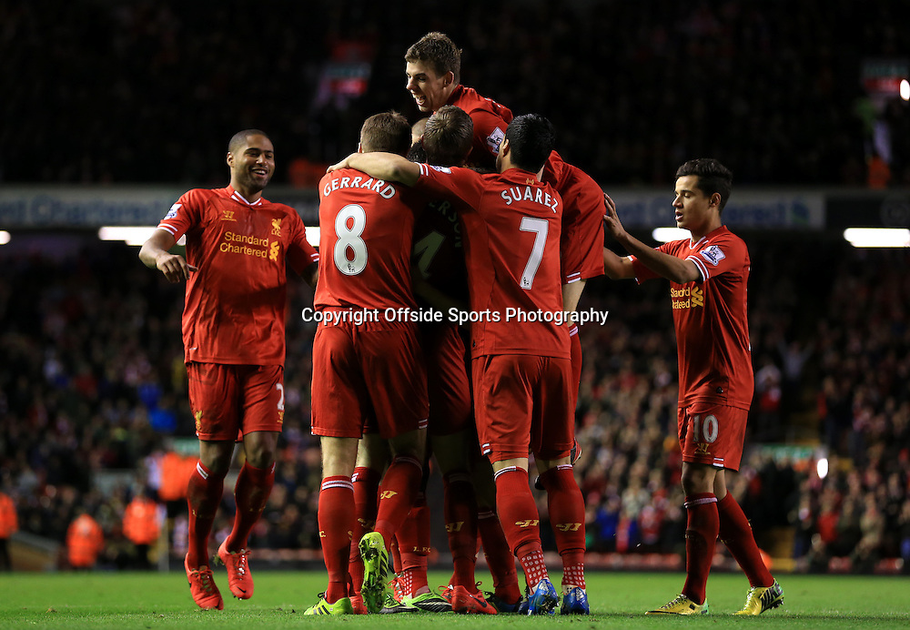 26th March 2014 - Barclays Premier League - Liverpool v Sunderland - Liverpool players jump on Daniel Sturridge of Liverpool as he celebrates after scoring their 2nd goal - Photo: Simon Stacpoole / Offside.