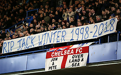 Fans hold up a banner in the stands during the Premier League match at Stamford Bridge, London