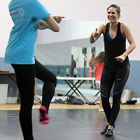 Alissa La Vergne, a Radio City Rockette, gives a thumbs up to student Emma Reid, 14, of New Albany, as she follows through with a dance at the North Mississippi Dance Centre's dance camp.