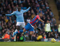 Benjamin Mendy of Manchester City (L) fouls Jordan Ayew of Crystal Palace - Mandatory by-line: Jack Phillips/JMP - 18/01/2020 - FOOTBALL - Etihad Stadium - Manchester, England - Manchester City v Crystal Palace - English Premier League