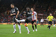 Mishit from Liverpool forward Christian Benteke  during the Barclays Premier League match between Sunderland and Liverpool at the Stadium Of Light, Sunderland, England on 30 December 2015. Photo by Simon Davies.
