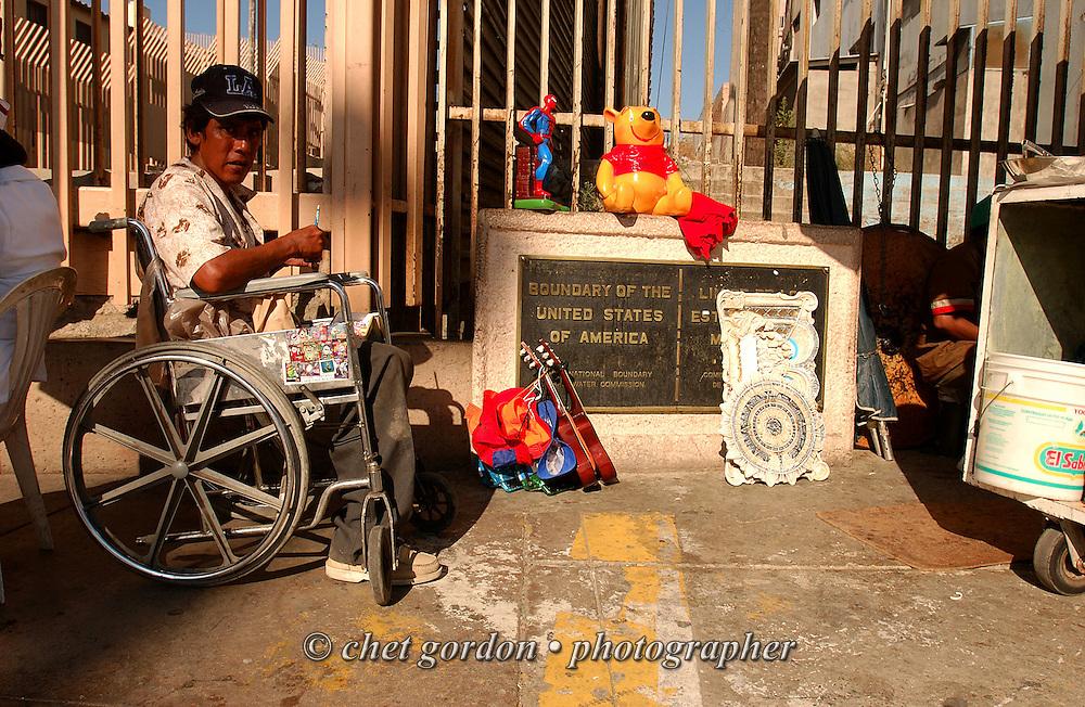 A man in wheelchair pauses near the US / Mexico border in Tijuana, Mexico on Tuesday, July 27, 2004. Tijuana, Mexico borders the US town of San Ysidro, CA.