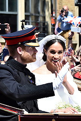 Prince Harry and Meghan Markle, the new Duke and Duchess of Sussex, during the carriage procession through Windsor after the Royal wedding