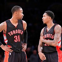 30 November 2014: Toronto Raptors forward Terrence Ross (31) talks to Toronto Raptors guard Louis Williams (23) during the Los Angeles Lakers 129-122 overtime victory over the Toronto Raptors, at the Staples Center, Los Angeles, California, USA.