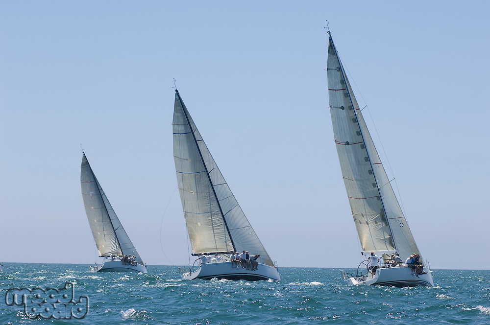 Three yachts compete in team sailing event California