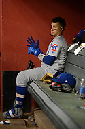 Aug 11, 2017; Phoenix, AZ, USA; Chicago Cubs infielder Javier Baez (9) adjusts hit batting gloves while sitting in the dugout during the game against the Arizona Diamondbacks at Chase Field. Mandatory Credit: Jennifer Stewart-USA TODAY Sports