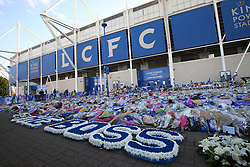 Wreaths reading THE BOSS, for Vichai Srivaddhanaprabha, left by Leicester City players at Leicester City Football Club.