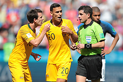 June 16, 2018 - Kazan, U.S. - KAZAN, RUSSIA - JUNE 16: forward Robbie Kruse of Australia , defender Trent Sainsbury of Australia and referee Andres Kunya during a Group C 2018 FIFA World Cup soccer match between France and Australia on June 16, 2018, at the Kazan Arena in Kazan, Russia. (Photo by Anatoliy Medved/Icon Sportswire) (Credit Image: © Anatoliy Medved/Icon SMI via ZUMA Press)