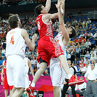 10 August 2012: Russia Sasha Kaun goes for the layup over Marc Gasol during 67-59 Team Spain victory over Team Russia, during the men's basketball semi-finals, at the North Greenwich Arena, in London, Great Britain.