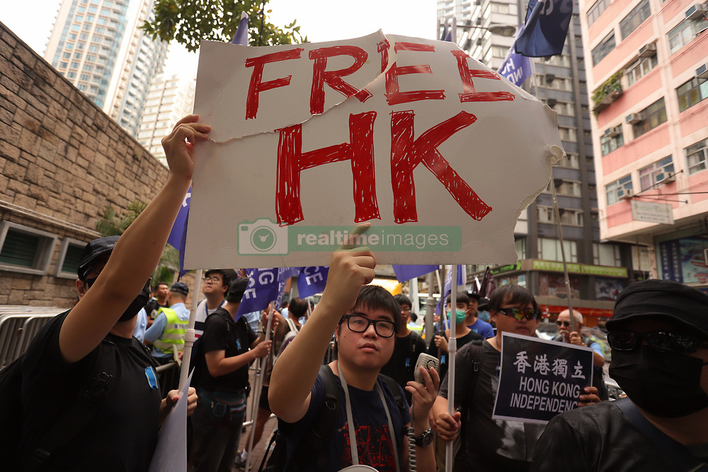 October 1, 2018 - Hong Kong, CHINA - Hong Kong independence advocates display torn up banner that reads FREE HK. Pro-democracy/Anti-Chinese Communists protesters staged a rally on the 69th anniversary of PRC national day calling for Hong Kong independence and political freedom. Oct-1,2018 Hong Kong.ZUMA/Liau Chung-ren (Credit Image: © Liau Chung-ren/ZUMA Wire)