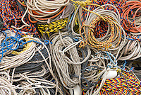 Coiled ropes on dock used for lobster fishing, Bristol Maine USA