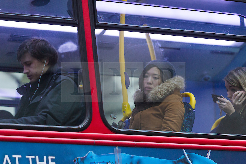 """© Licensed to London News Pictures. 18/01/2016. London, UK. Comuters sit on a bus waiting in traffic near Waterloo station this morning. Today, known as """"Blue Monday"""" is meant to be the most depressing day of the year. Photo credit : Vickie Flores/LNP"""