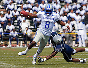 "Hampton University quarterback David Lagree (8) avoids Howard University freshman defensive end Toavon Sheats (90) during Hampton's 31 - 21 victory in ""The Battle of the Real HU's"" held at Green Stadium on the campus of Howard University in Washington, DC.   (Photo by Mark W. Sutton)"