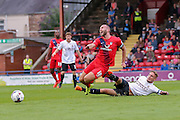 Russell Penn gets fouled by Gary Liddle during the Capital One Cup match between York City and Bradford City at Bootham Crescent, York, England on 11 August 2015. Photo by Simon Davies.