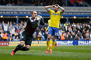 Leeds United midfielder Stuart Dallas (15) looks on as Birmingham City goalkeeper Lee Camp clutches the ball during the EFL Sky Bet Championship match between Birmingham City and Leeds United at St Andrews, Birmingham, England on 6 April 2019.