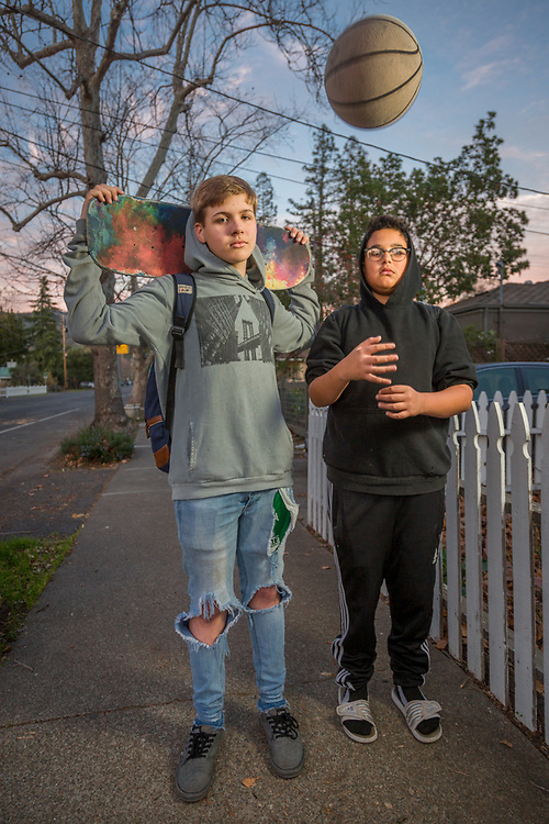 """Our dads used to work together and we've know each other since we were three.""   -Twelve year old friends Nathan Link and Christian Fernandez head home down Lake Street after shooting baskets at the high school in Calistoga."