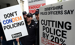 © Licensed to London News Pictures. 10/05/2012. Westminster, UK Policemen hold banners at Millbank. Off duty police officers take part in a Police Federation protest over proposed changes to pay and conditions. Tony Melville, the outgoing chief constable of Gloucestershire Police, was among the marchers. Photo credit : Stephen Simpson/LNP