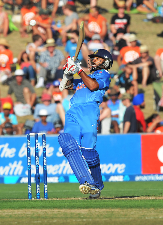 India's Shikhar Dhawan bats against New Zealand in the first one day International cricket match, McLean Park, New Zealand, Sunday, January 19, 2014. Credit:SNPA / Ross Setford