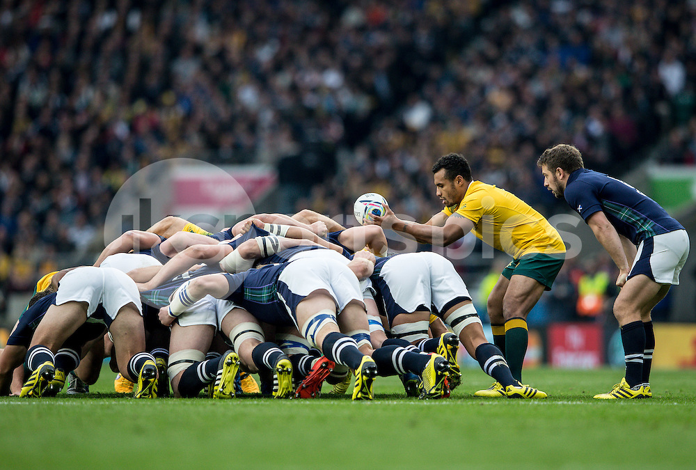 Will Genia of Australia feeds the scrum during the Rugby World Cup Quarter Final match between Australia and Scotland played at Twickenham Stadium, London on the 18th of October 2015. Photo by Liam McAvoy.