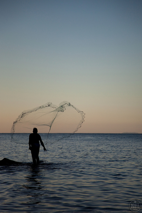 """""""Old Man Tossing Net 2"""" - This old man tossing a fishing net was photographed in Puerto Vallarta, Mexico."""