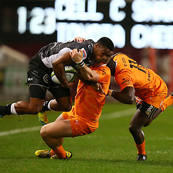 DURBAN, SOUTH AFRICA, 9,JULY, 2016 S'bura Sithole of the Cell C Sharks tackled by Michael van der Spuy of the Toyota Cheetahs during The Cell C Sharks vs Toyota Cheetahs  Super Rugby Match at Growthpoint Kings Park in Durban, South Africa. (Photo by Steve Haag)<br /> <br /> images for social media must have consent from Steve Haag