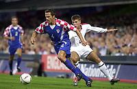 Photo. Glyn Thomas<br />England v Croatia - international friendly.<br />Portman Road, Ipswich. 20/08/2003.<br />England's Steven Gerrard is held off by Stjepan Tomas.