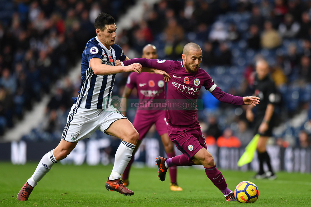 West Bromwich Albion's Gareth Barry (left) and Manchester City's David Silva battle for the ball